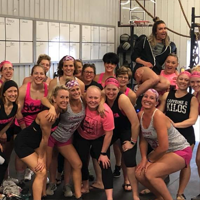 Woman's crossfit training group.
